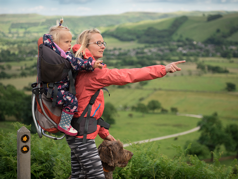 Mum and toddler in carrier in countryside