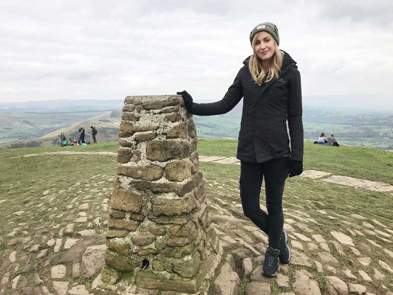 Katherine Kelly at the Trig Pillar on the summit of Mam Tor - © ITV Picture Desk